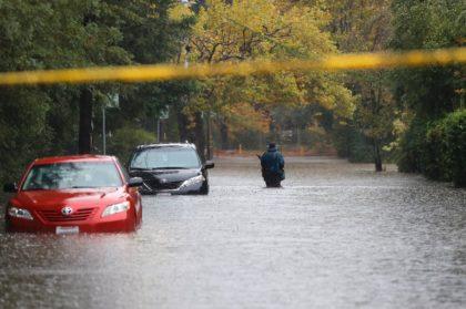 A pedestrian walks on a flooded street on October 24, 2021 in Kentfield, California