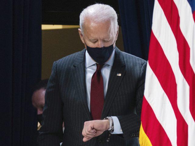 Joe Biden checks watch (Evan Vucci / Associated Press)