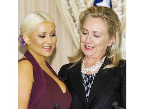 Caption This Photo: Hillary Sneaks a Peek at Christina Aguilera