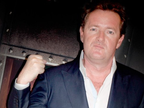 Piers Morgan Chats Up Moore, Ignores Filmmaker's Vulgar Anti-Romney Ad