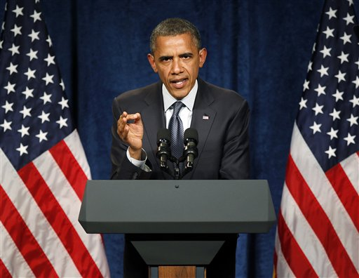 Obama on the defensive on spending, debt
