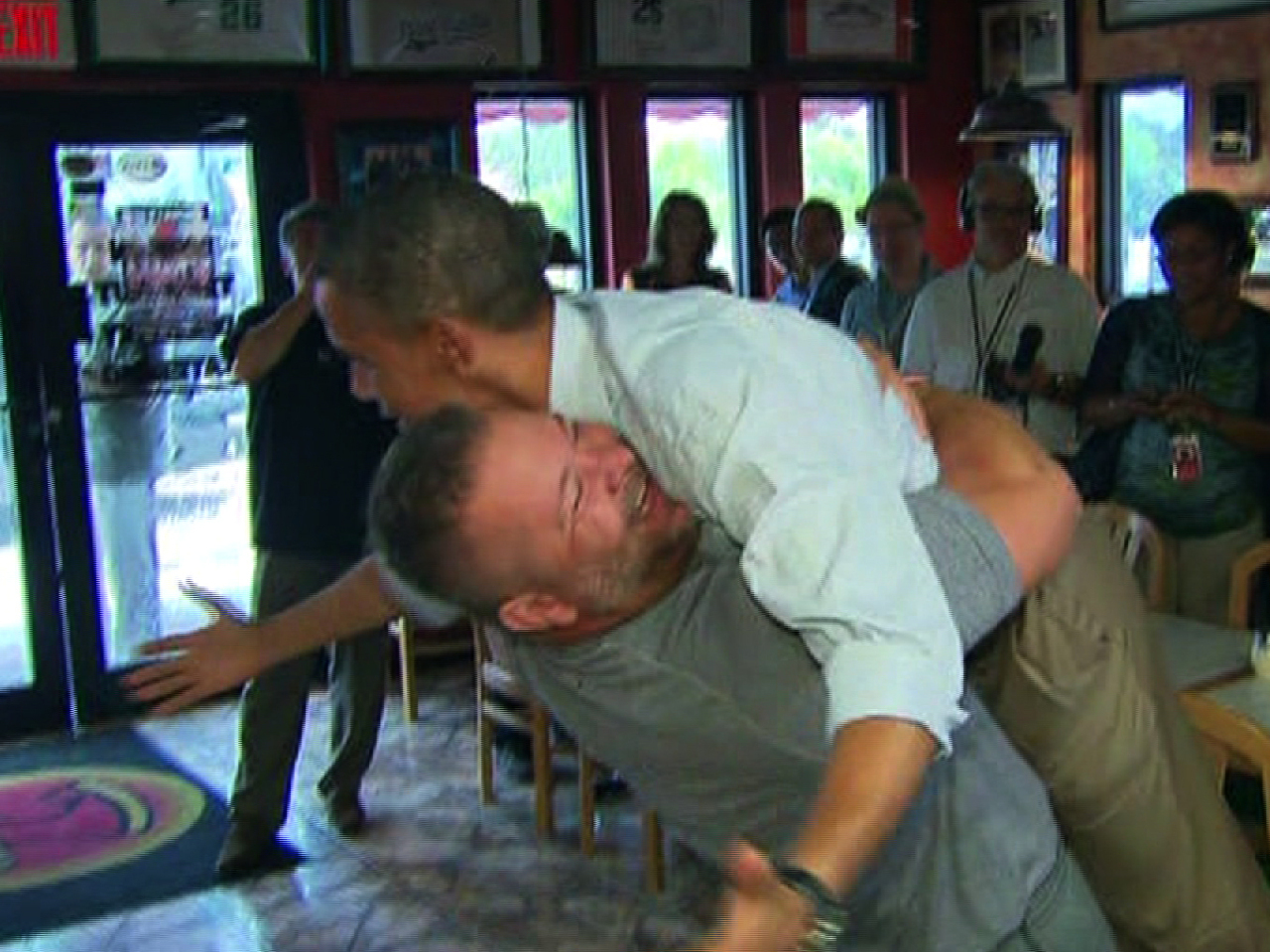 Obama Hug: Florida Pizza Shop Owner Facing Boycotts