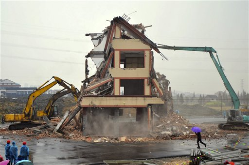 Lone Chinese home destroyed; farmer accepts deal
