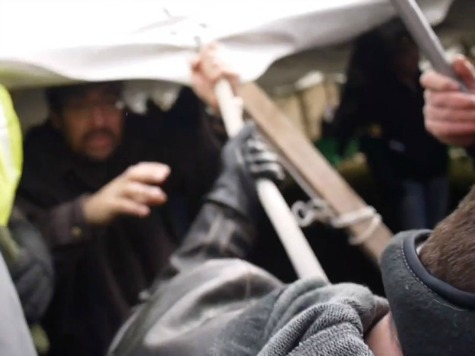Exclusive Video: MI Pro-Union Crowd Destroys Tent with People Inside