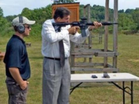 Photos of Assault Rifle Critic Manchin Shooting Assault Rifle