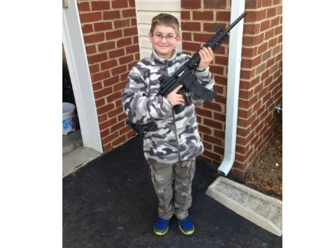 Child Services, Police Descend on Home After 10-Year Old Poses with Hunting Rifle