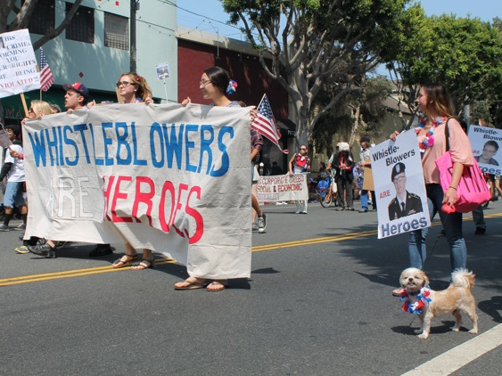 Activists Celebrate Snowden as American Hero in July 4th Parade