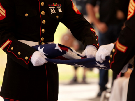 Retirement Community Board Votes 'No' on Marine alongside American Flag