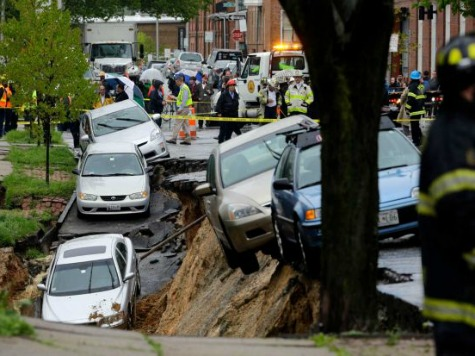 Sinkhole Swallows Parked Cars in Baltimore