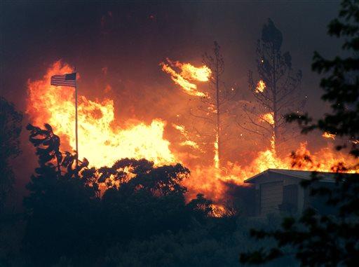 Gusty winds fuel destructive Washington wildfire