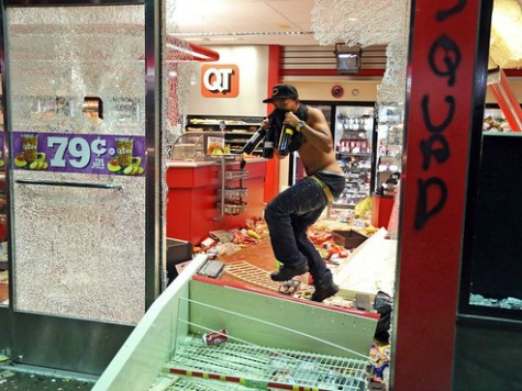 Looters Ransack, Burn St. Louis Stores After Police Shooting of Black Teen