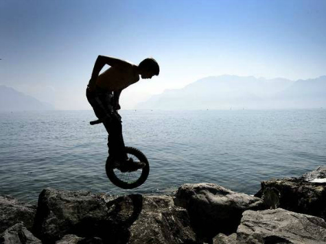 Man Unicycles Across Canada for Global Warming During Record-Breaking Cool Summer