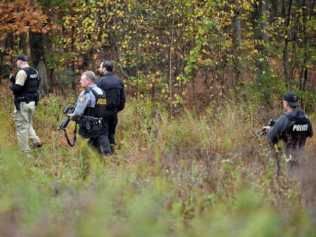Pennsylvania Cop Murder Suspect Evades Police in Woods, Camouflaged with Mud