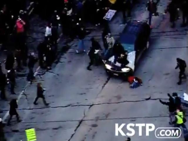 Caught on Tape: Car Runs over Ferguson Protester in Minneapolis