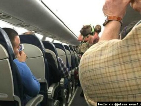 Woman Kicked Off Plane over Antics of 'Companion Pig'