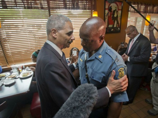 As Protesters Interrupt, Eric Holder Announces Plan to 'Target Racial Profiling'