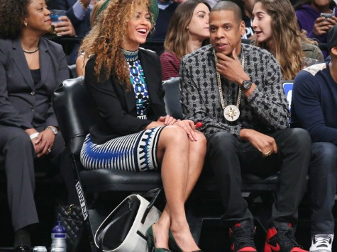 Jay-Z Sports Bling from 'Whites Are Devils' Group While Courtside with Beyonce
