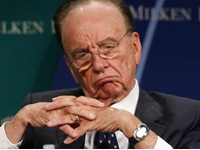 Murdoch resigns from U.K. papers