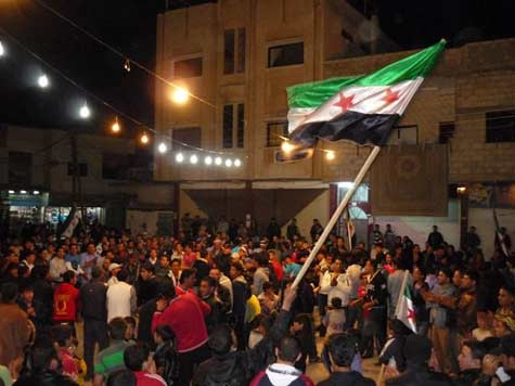 Syria troops kill three as thousands march: monitors