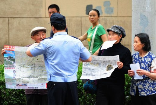 Blind activist says China authorities targeting relatives