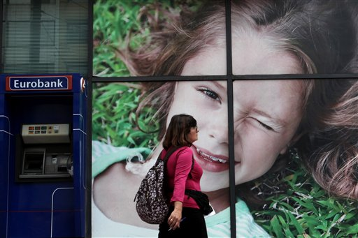 Greek euro exit would halve incomes, report warns