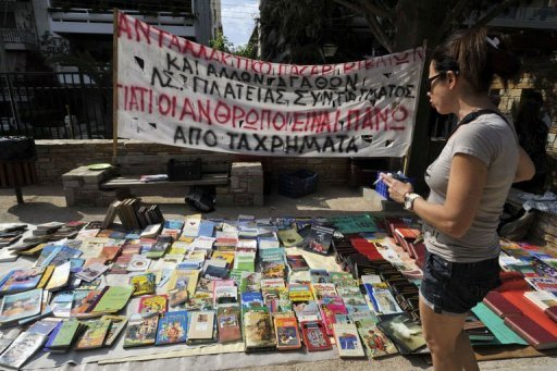 Short of euros, Greeks trade time and barter