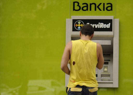German bank chief urges Madrid to seek bailout
