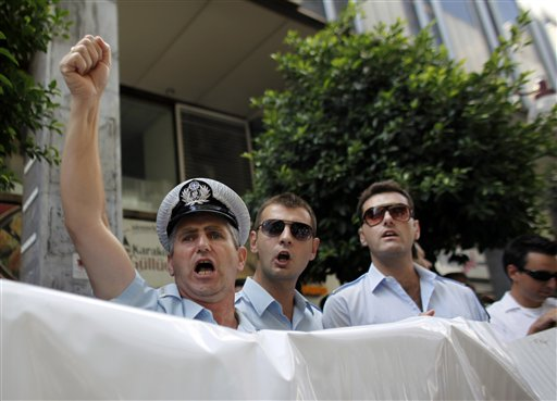 Greek police unionists protest planned pay cuts
