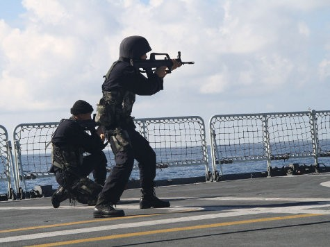 World View: U.S. and China Threaten Each Other on South China Sea