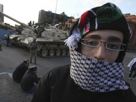 Morsi Brings Out Tanks, Blames 'Hidden Hands' for Unrest