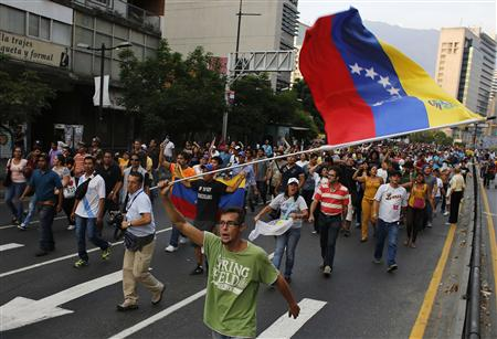 Venezuelan rivals rally supporters, four people reported dead
