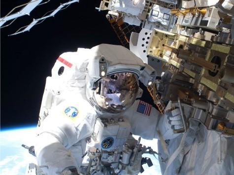Spacewalking Astronauts Hunt for Big Station Leak