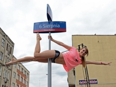 Poles Dancing: Women Swing Around Poland's Signposts
