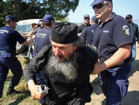 Greek Monks Hurl Petrol Bombs at Bailiffs