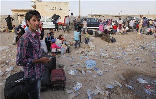 Syrian Kurds Battle al-Qaida-Linked Rebel Faction