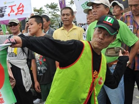Protesters Hurl Shoes as Taiwan's Ruling Party Meets