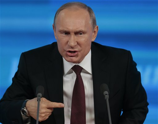 Putin Triumphs in 2013 Yet Tough Challenges Loom