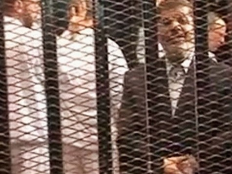 Ousted Egypt Leader in Glass-Encased Cage at Trial