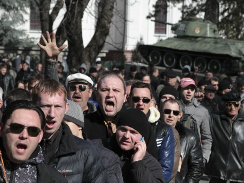 Pro-Russia Activists Hijack Crimean Parliament in Ukraine as Putin Moves Troops Near