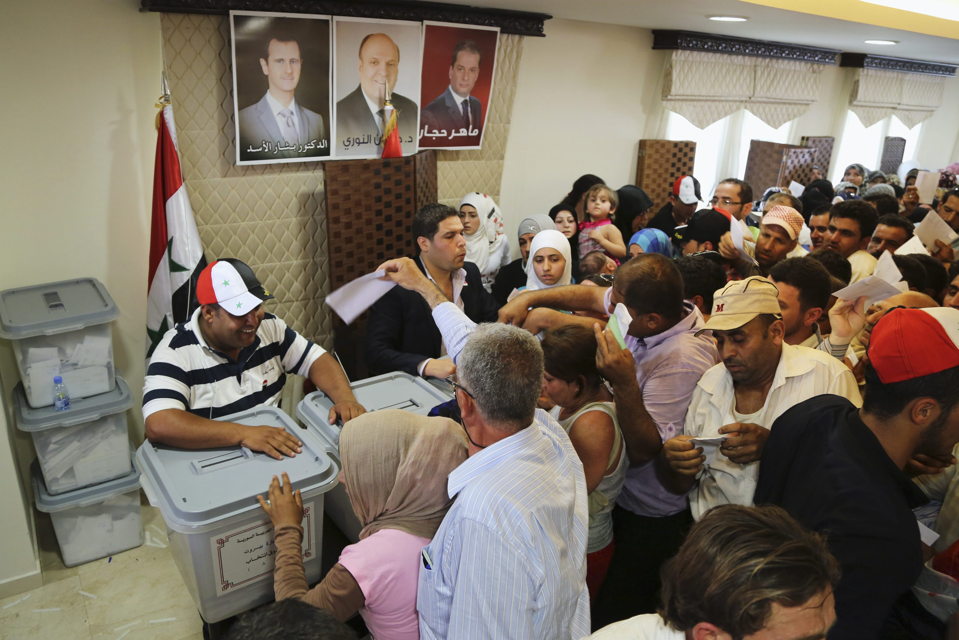Tens of Thousands of Syrians Abroad Vote in Early Poll