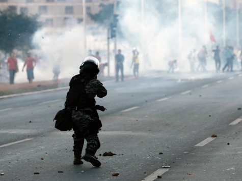 Police Use Tear Gas to Block Protesters from World Cup Stadium