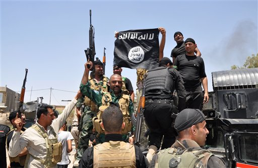Iraqi Forces Clash with Militants in Tikrit