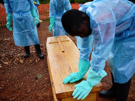 Men Dig Up Coffin of Suspected Ebola Victim, Place on Highway in Protest