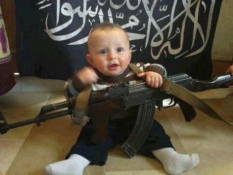 Islamic State Posts Picture of Baby in ISIS Onesie, Another Baby with Rifle