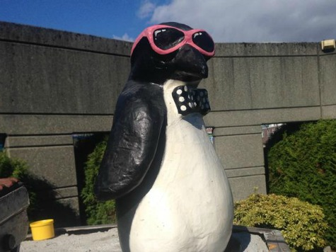 Bowtie-Clad Penguin Takes Naked Satan Statue's Place