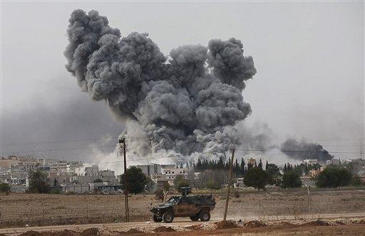 Activists: Kurds Halt Jihadi Advance in Syria Town