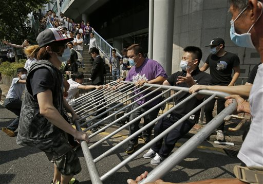 Hong Kong Protesters Boost Barricades After Clash