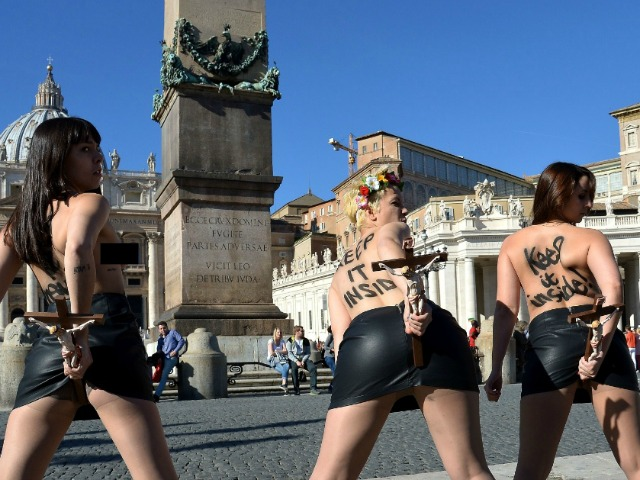 Topless Femen Protesters Desecrate Crucifixes in St. Peter's Square