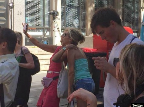 Bystanders Taking Selfies Outside Lindt Cafe in Sydney Spark Outrage