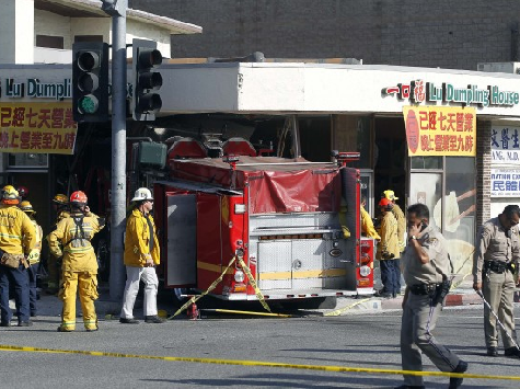 Fire Trucks Crash Through Wall of Restaurant, Injure 15
